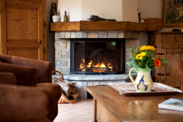 Log Fire in Alpine Action Chalet